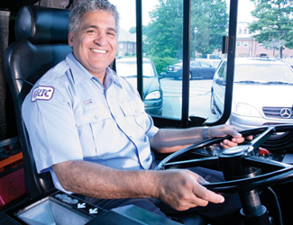 GRTC bus operator smiling on bus